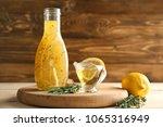 bottle with tasty sauce  lemons ... | Shutterstock . vector #1065316949