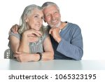 portrait of hugging senior... | Shutterstock . vector #1065323195