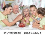 big happy family eating fresh... | Shutterstock . vector #1065323375