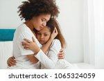 mother comforting her daughter  ... | Shutterstock . vector #1065324059