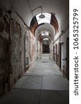 Small photo of Philadelphia, Pennsylvania, USA – August 1, 2016: Vertical view of one of the Eastern State Penitentiary corridors, Philadelphia, Pennsylvania