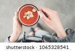 woman holding tomato soup cup... | Shutterstock . vector #1065328541