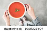 woman holding tomato soup pot... | Shutterstock . vector #1065329609