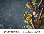 spices and herbs over black... | Shutterstock . vector #1065332645