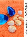 blue fashion sunglasses and sea ... | Shutterstock . vector #1065350969