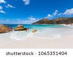 little beach with white sand ... | Shutterstock . vector #1065351404