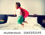 african descent kid jumping on...   Shutterstock . vector #1065353195