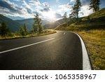 asphalt road in austria  alps... | Shutterstock . vector #1065358967