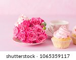 cupcake with pink cream... | Shutterstock . vector #1065359117