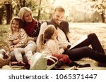 happy family having picnic.... | Shutterstock . vector #1065371447