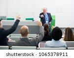 confident senior businessman... | Shutterstock . vector #1065378911