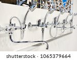 mixers taps for shower in a... | Shutterstock . vector #1065379664