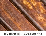 two lacquered brown boards part ...   Shutterstock . vector #1065385445