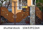wooden gate with beautiful... | Shutterstock . vector #1065392264