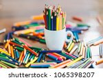 colored pencils in a glass on... | Shutterstock . vector #1065398207
