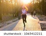young woman in headphones...   Shutterstock . vector #1065412211
