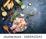 raw fish with seasonings  oil ... | Shutterstock . vector #1065413141