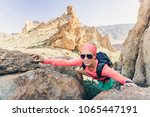 woman hiker reached mountain... | Shutterstock . vector #1065447191