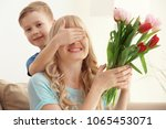 cute little boy surprising his... | Shutterstock . vector #1065453071