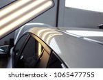hail damage on a car  lights... | Shutterstock . vector #1065477755