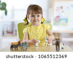 little girl playing with animal ... | Shutterstock . vector #1065512369