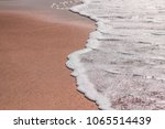 Soft Wave Foam On Sandy Beach...