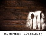 cutlery contour on wood... | Shutterstock . vector #1065518357