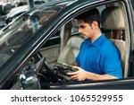 professional mechanic repairing ... | Shutterstock . vector #1065529955