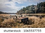 wreck of a small boat on the... | Shutterstock . vector #1065537755