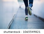 an active fit woman running in... | Shutterstock . vector #1065549821
