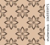 brown floral ornament on beige... | Shutterstock .eps vector #1065555971