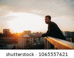young man is pondering on... | Shutterstock . vector #1065557621
