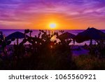colorful and brilliant sunset... | Shutterstock . vector #1065560921