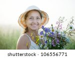 Mature Woman With Flowers Posy...
