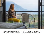 young happy woman woke up in... | Shutterstock . vector #1065575249