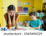 asian woman teacher get... | Shutterstock . vector #1065604229
