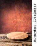 empty pizza round board  old...   Shutterstock . vector #1065605555