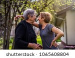 very old woman bonding with her ... | Shutterstock . vector #1065608804