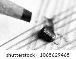 Small photo of Lead pencil and paper so close, macro