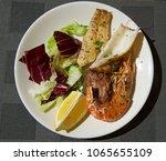 fresh king prawns and calamari... | Shutterstock . vector #1065655109