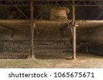 single hay bale on barn top... | Shutterstock . vector #1065675671