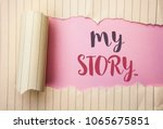 Small photo of Writing note showing My Story.... Business photo showcasing Biography Achievement Personal History Profile Portfolio written on the pink background behind Tear Notebook Paper.