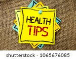 Small photo of Text sign showing Health Tips. Conceptual photo Healthy Suggestions Suggest Information Guidance Tip Idea written on Sticky Note Paper attached to jute background with Thumbpin on it.