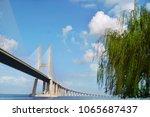 vasco da gama bridge in lisbon  ... | Shutterstock . vector #1065687437