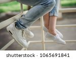feet of a loving couple in... | Shutterstock . vector #1065691841