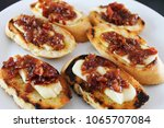 bourbon bacon jam and brie...   Shutterstock . vector #1065707084