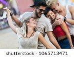happy friends having fun at... | Shutterstock . vector #1065713471