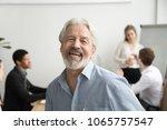 happy senior businessman... | Shutterstock . vector #1065757547