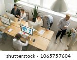 young and senior office... | Shutterstock . vector #1065757604