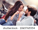 happy young couple having fun... | Shutterstock . vector #1065765554
